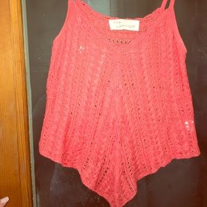This is a knit top made of 100% acrylic
